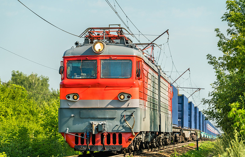 Rail transport - important part of transportation - freight train - red electric locomotive with wagons