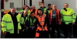 ESA logistika employees in protection yellow or orange vest