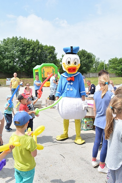 Donald duck with playing children