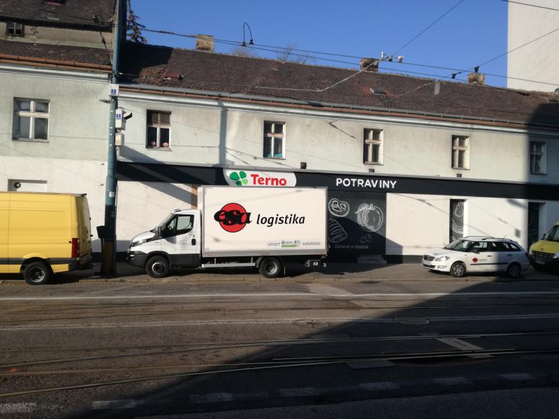 1 Delivery van with logo Green3PL closed to Terno shop
